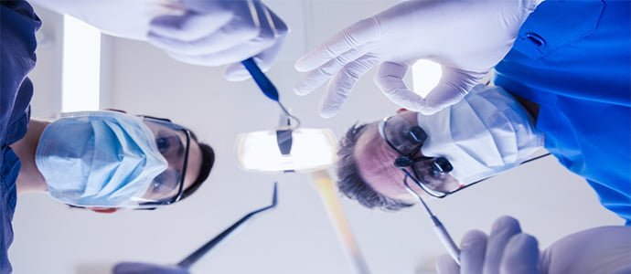 dentists looking down on patient