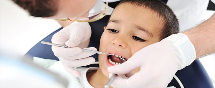 Why are children not attending the dentist?