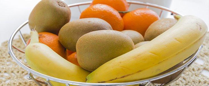bowl of bananas, kiwis and oranges