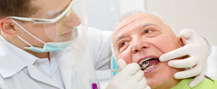 elderly man in dental chair